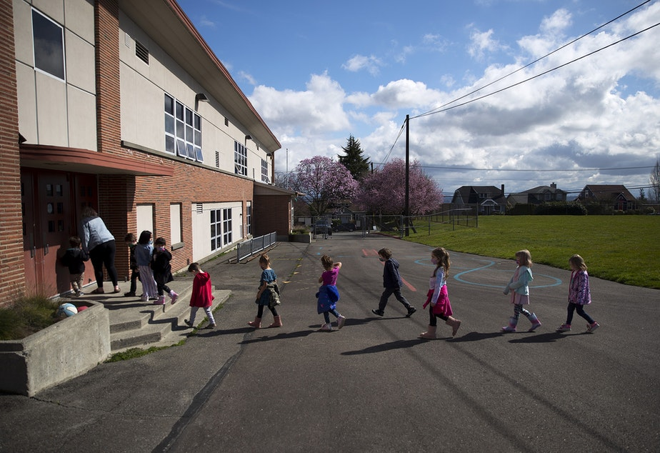 caption: Jackson Elementary kindergarten students return from recess on Tuesday, March 23, 2021, at Jackson Elementary School along Federal Avenue in Everett. With hybrid learning, students have the option to attend in-person classes two days per week.