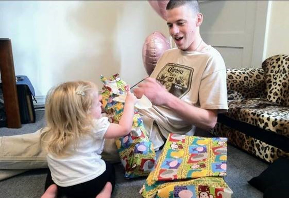 caption: Jeremy Lavender, an Iraq war veteran who struggled with PTSD and traumatic brain injury, at his daughter's first birthday in 2010. Lavender died after being held at the Chelan County Jail on shoplifting and drug charges seven years later.