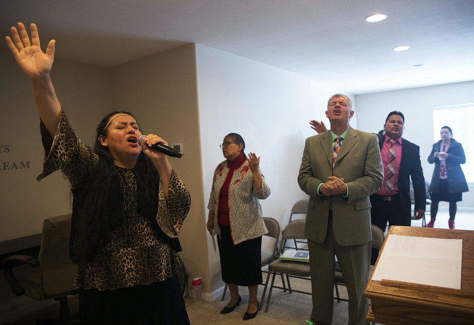 Magdalena Lopez-Muñoz translates a church service in the basement of Nathan Robert's home on Sunday, September 16, 2018, in Des Moines.