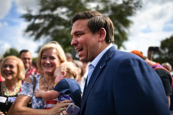 Ron DeSantis meets with supporters at a rally Monday in Orlando, Fla.