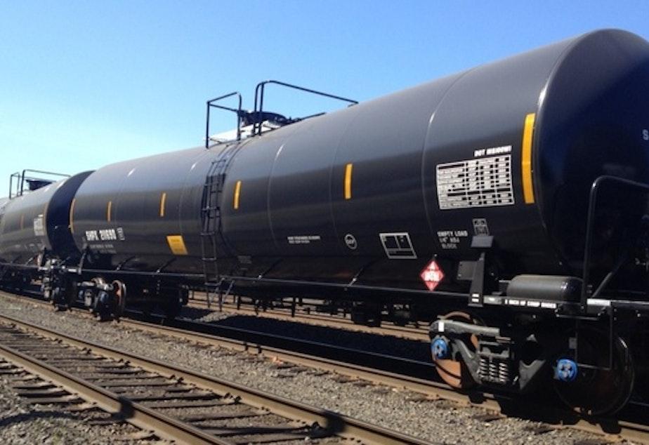 caption: File photo of oil train tankers in a Portland, Ore. railyard.