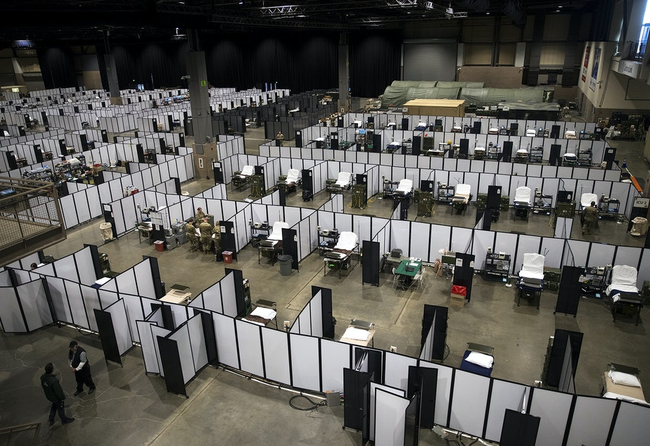 caption: U.S. Army soldiers set up a military field hospital inside CenturyLink Field Event Center on Sunday, April 5, 2020, in Seattle. The 250-bed hospital for non COVID-19 patients was deployed by soldiers from the 627th Army Hospital from Fort Carson, Colorado, as well as soldiers from Joint Base Lewis-McChord.