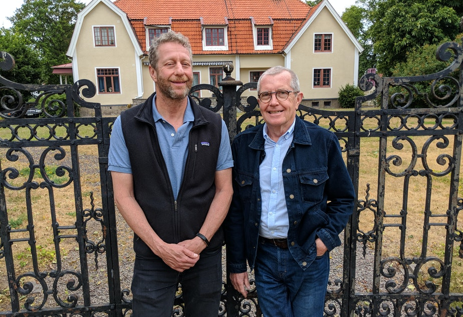 Uri Berliner stands with Swedish journalist Claes Furstenberg in front of the former Furstenberg family home in Kalmar, Sweden.