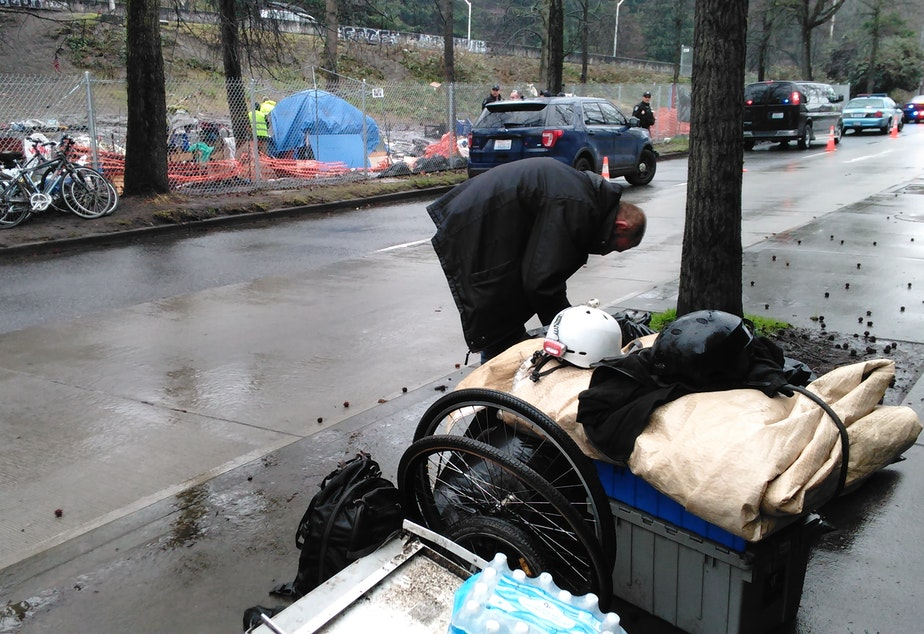 caption: George Kerns is moving to another homeless camp. He knows it won't be the last time he's told to move on