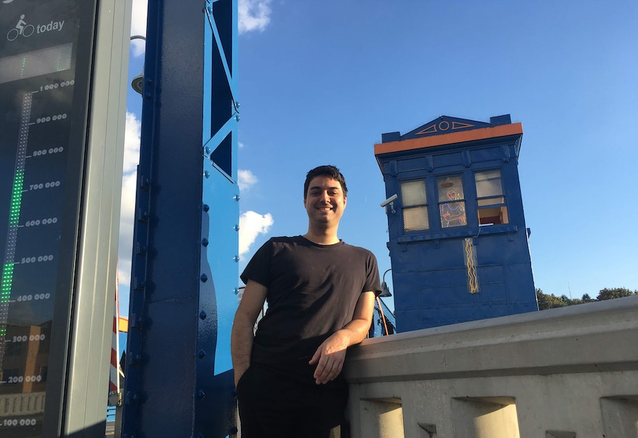 caption: Composer Paurl Walsh outside his summer office as the Fremont Bridge Artist in Residence.