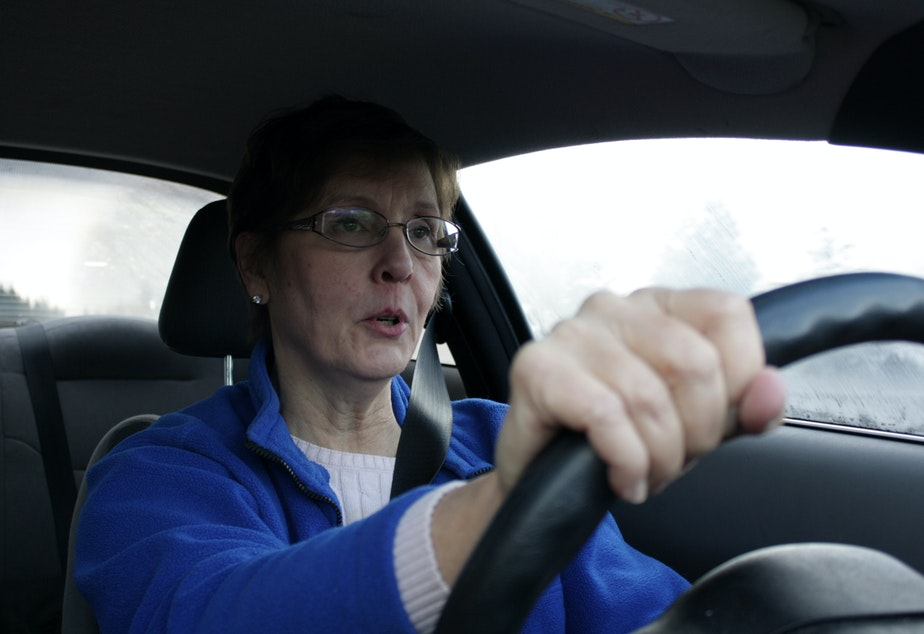 caption: Cynthia Ulrich of Stop 405 Tolls looks unhappy as she prepares to enter the toll lane for the first time.