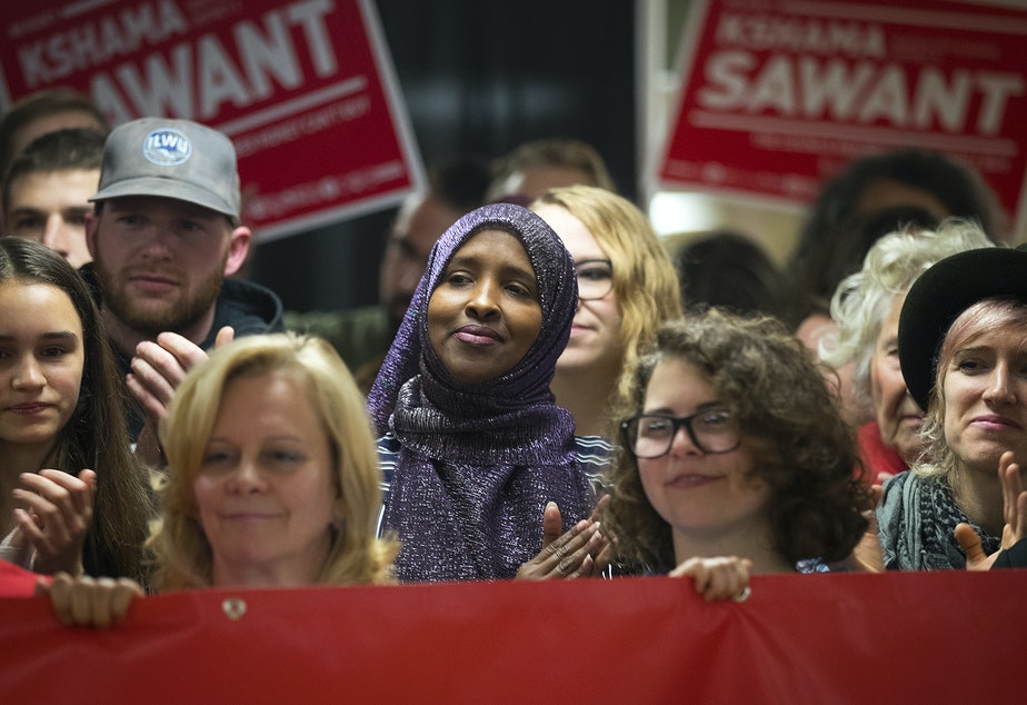 Supporters including Ubah Warsame-Aden, center, clap for Seattle City Councilmember Kshama Sawant during a press conference on Saturday, November 9, 2019, at Langston Hughes Performing Arts Institute in Seattle.