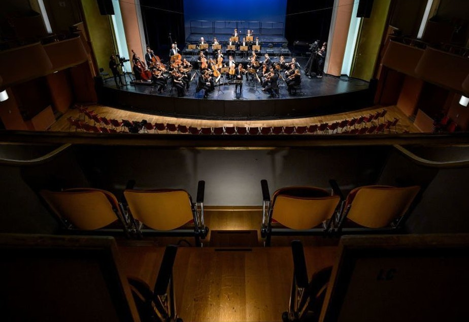 caption: Due to coronavirus fears, violinist Renaud Capuçon and the Lausanne Chamber Orchestra play for an empty hall in Lausanne, Switzerland on March 4. (The concert was broadcast by Swiss public media.)