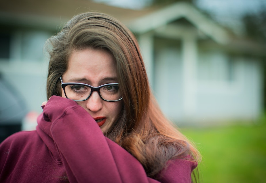 caption: Outside the home of her foster sister Renee Davis, Danielle Bargala breaks down in tears while talking about how Davis' young children are living with different families. Davis, who was pregnant, was shot at her Muckleshoot reservation home last October.