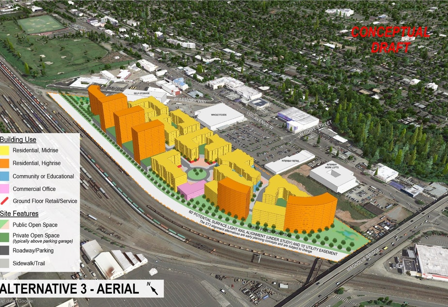 caption: Makers Architecture and Urban Design examined various scenarios, from leaving the low density industrial zoning on the property as is, to rezoning it for residential towers as shown here. Next to the rail yard is the future light rail line (route still to be finalized) and a bike trail.