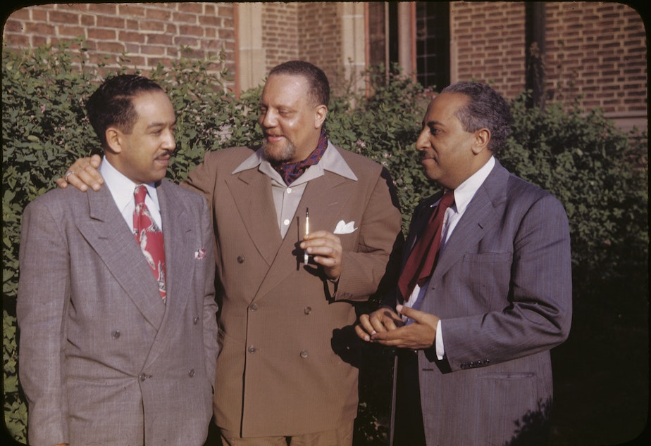 caption: Horace Cayton Jr., center, as an adult. Cayton worked many jobs before becoming an esteemed sociologist in Chicago - longshoreman and Seattle's first black deputy, among others.