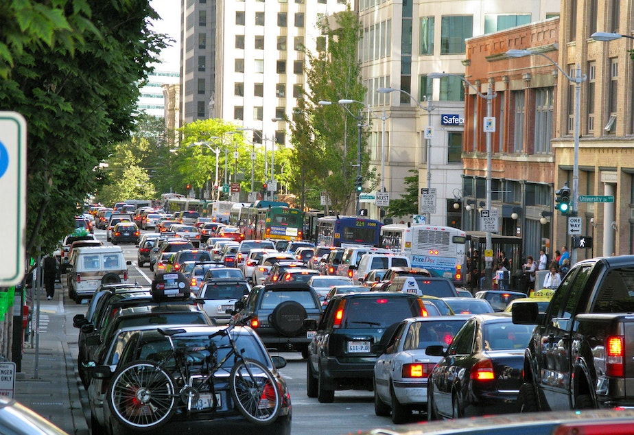 caption: Traffic on Second Avenue in downtown Seattle.