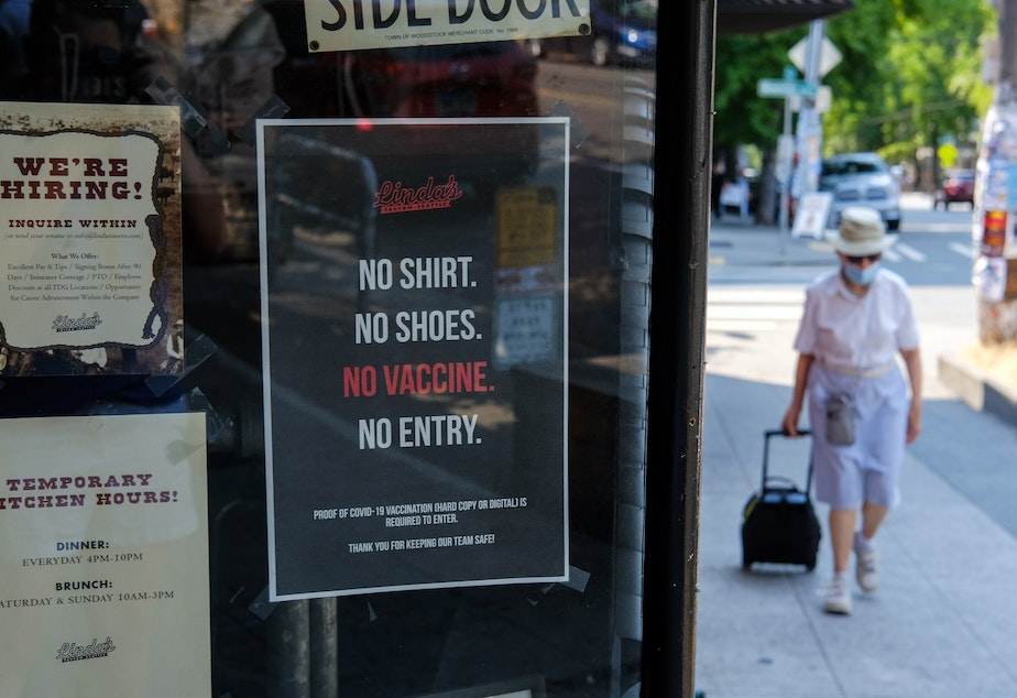 """caption: A sign that reads """"no shirt, no shoes, no vaccine, no entry"""" is posted outside Linda's Tavern on Capitol Hill, Monday, August 2, as they and many other area bars and restaurants have begun requiring proof of vaccination for their patrons."""