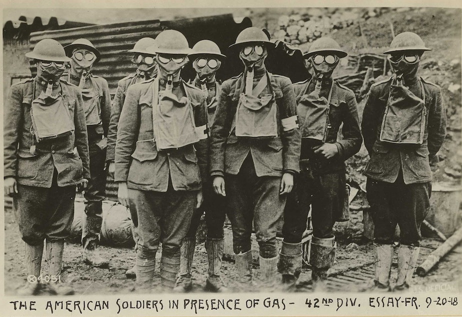 caption: American soldiers in presence of gas, 42nd division. Essey, France. September 20, 1918.
