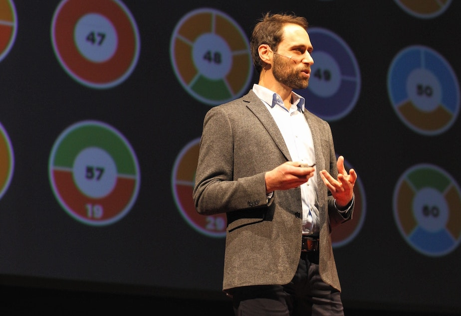 caption: Dan Finkel on the TED stage.