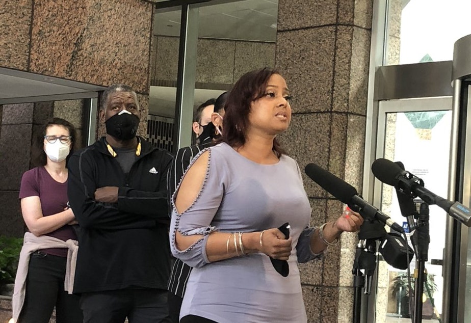 caption: Devitta Briscoe with Not this Time speaks at a press conference Aug. 20, 2020 in support of Seattle Police Chief Carmen Best.