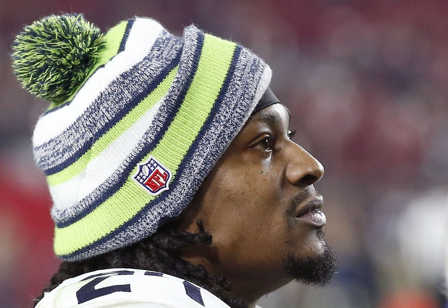 Seattle Seahawks' Marshawn Lynch watches the closing moments of an NFL football game against the Arizona Cardinals Sunday, Dec. 21, 2014.