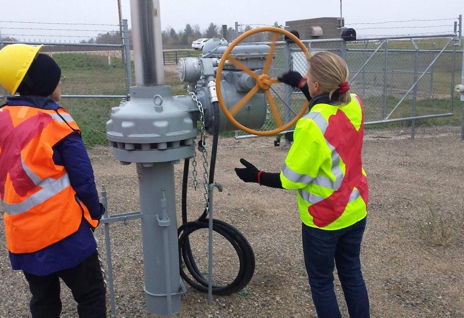 Klapstein (left) and Johnston cut through chains to get access to Enbridge pipelines near Leonard, Minnesota.