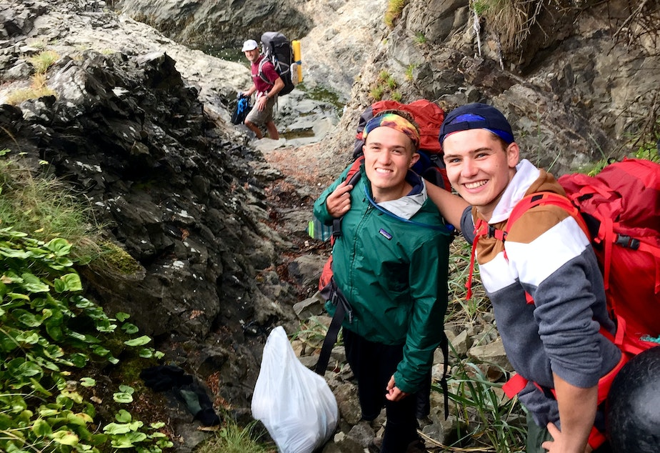 caption: Benji Backer (center) and Camden Bendickson on a hike along the Olympic coast in August. Backer is the president of the American Conservation Coalition; Bendickson is an intern. Republican Bill Bryant led the three-day trip to mark the 60th anniversary of a similar journey by Supreme Court Justice William O. Douglas.