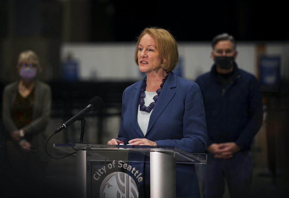 caption: Seattle mayor Jenny Durkan speaks to the press at a mass Covid-19 vaccination site set to open on Saturday on Wednesday, March 10, 2021, inside the Lumen Field Events Center in Seattle. The site will be the largest civilian-led vaccination site in the country.