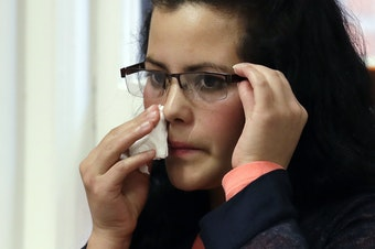 Yolany Padilla, an asylum seeker separated from her 6-year-old son as part of the Trump Administration's 'zero tolerance' policy, wipes her face as she sits at a news conference Wednesday, July 11, 2018, in Seattle.