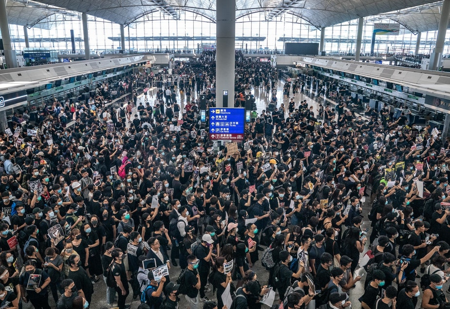 caption: Pro-democracy protesters occupy the departure hall of the Hong Kong International Airport, which was closed on Monday.
