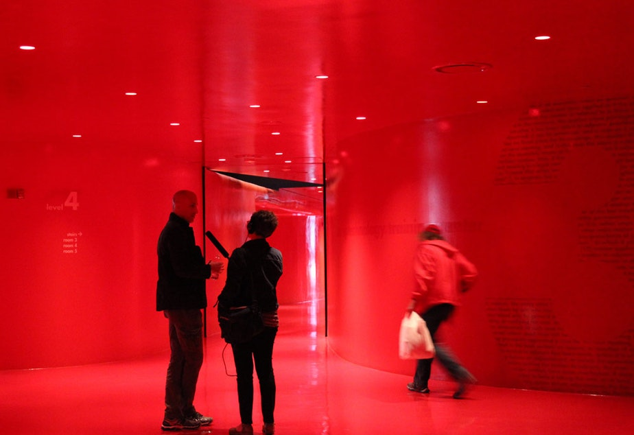Managing architect Joshua Prince-Ramus and KUOW's Marcie Sillman on the fourth level where the meeting rooms are. The walls, ceiling and floors are painted four different shades of red, hence the floor's nickname: the womb.