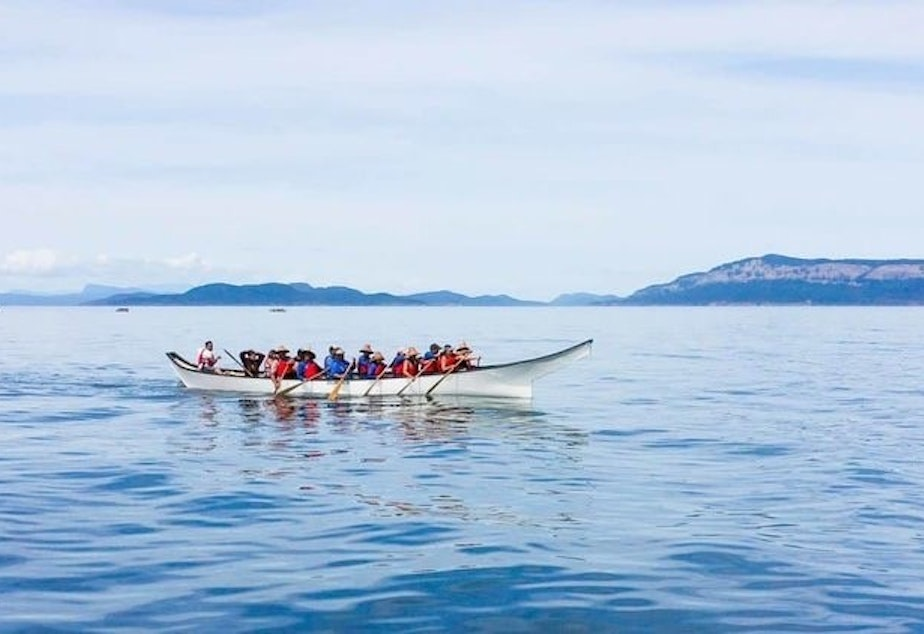 caption: A canoe with Lummi tribal members.
