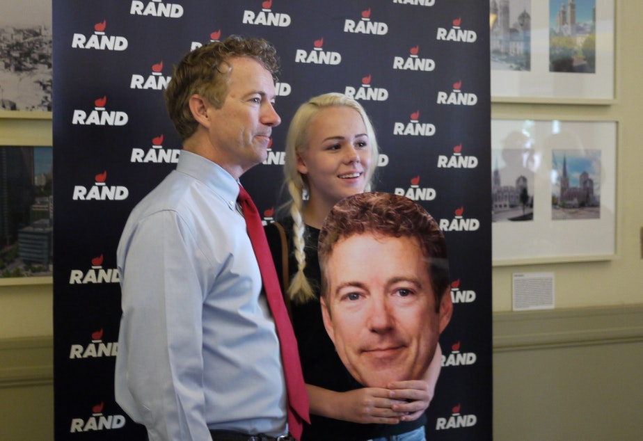 caption: Portland teen Angela Wilcox poses with presidential candidate Rand Paul at a rally in Seattle.
