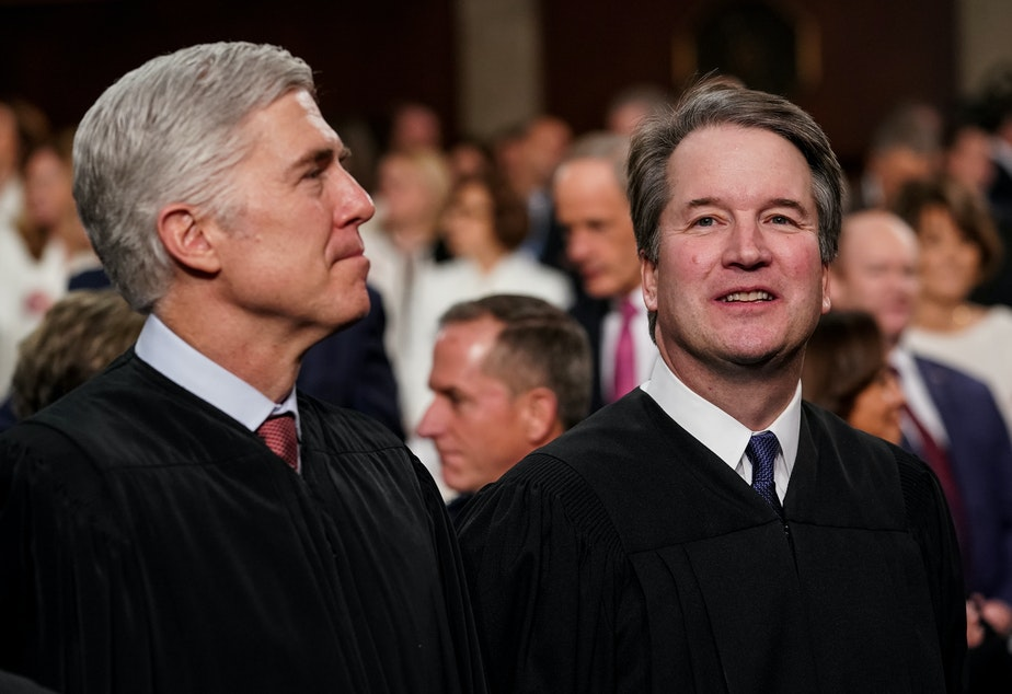 Supreme Court Justices Neil Gorsuch (left) and Brett Kavanaugh wrote opposing opinions in a high-profile case involving Apple's App Store. The two Trump appointees are seen here at the Capitol in February.