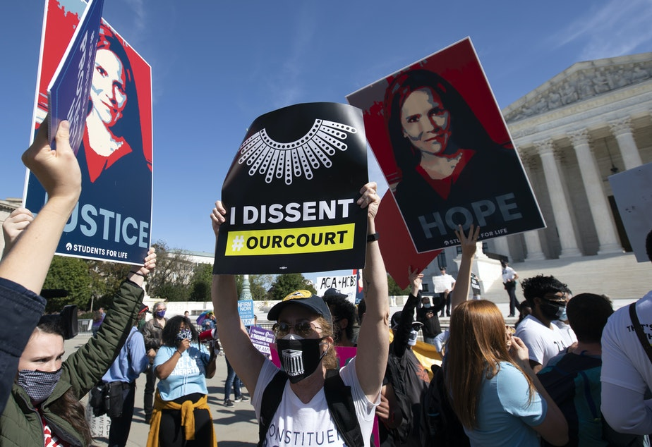 caption: Supporters and opponents of the confirmation of Judge Amy Coney Barrett rally Wednesday at the Supreme Court. On Thursday, witnesses will speak at the Senate Judiciary Committee for and against President Trump's nominee to the court.