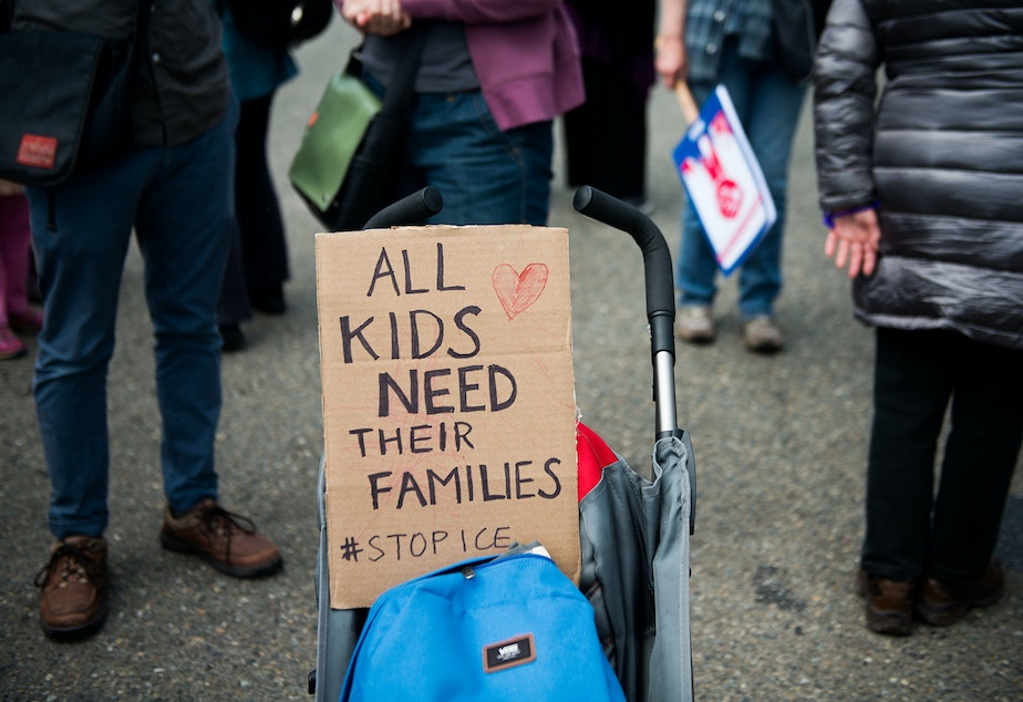A stroller was used to hold up a sign during the Solidarity Day protest outside of the Federal Detention Center in SeaTac.