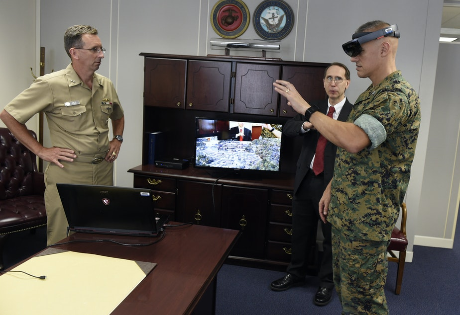 "Col. William Bentley, Office of Naval Research deputy for the expeditionary maneuver warfare and combating terrorism department, joins the Chief of Naval Research, Rear Adm. David Hahn, for a demonstration of the ""Tactical Decision Kit"" that includes a Microsoft HoloLens headset."