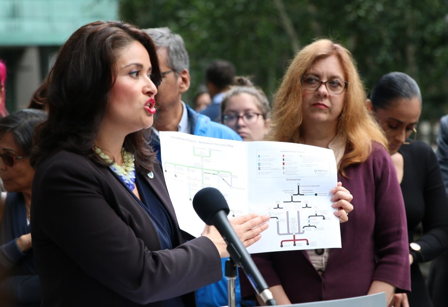 caption: Seattle City Councilmember Lorena González at a press conference on July 15, 2019, explains the complex accountability process following police violence.