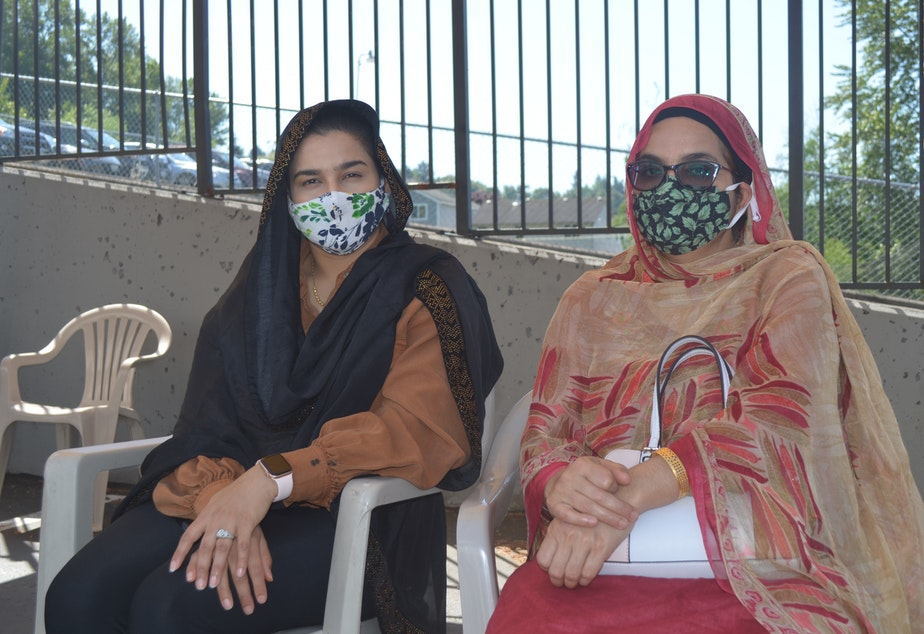 caption: Harinder Dhanda (left) and her mother-in-law Kamaljeet Kaur got vaccinated at a Sikh temple in Renton.