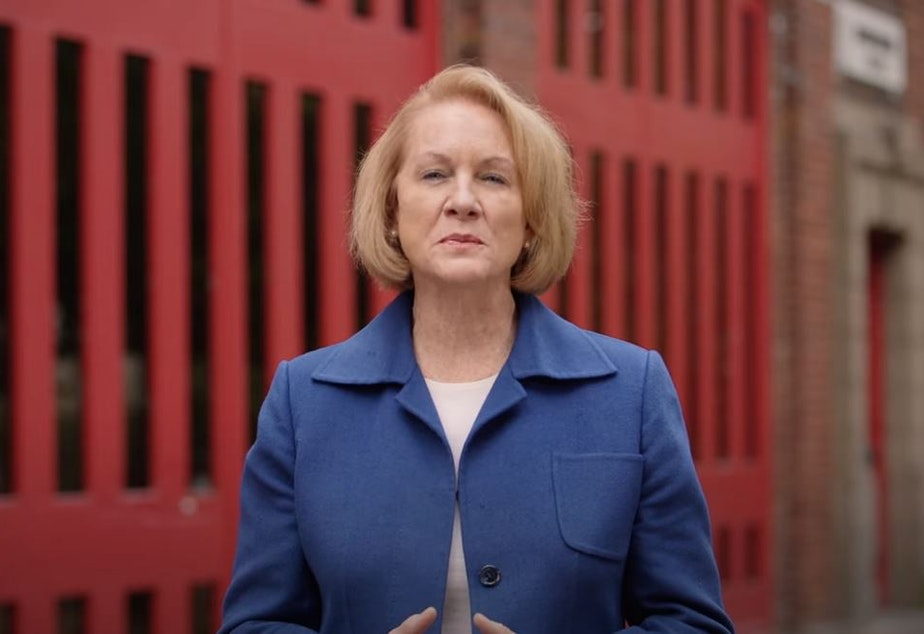 caption: Seattle Mayor Jenny Durkan delivers a brief address about her final city budget proposal as mayor on September 27, 2021.