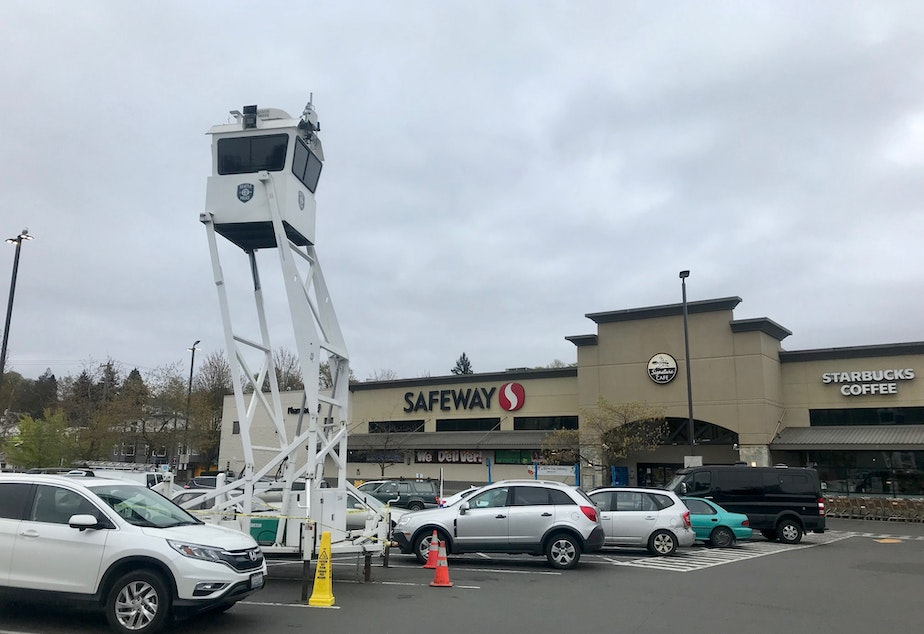 caption: The Seattle Police Department's mobile SkyWatch surveillance tower stands outside the Mt. Baker Safeway in south Seattle on April 10, 2019.