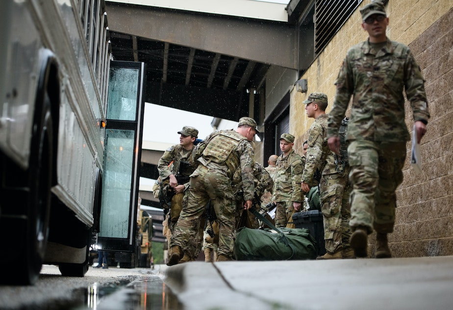 caption: Troops from the Army's 82nd Airborne Division prepare to deploy to the Middle East on Saturday at Fort Bragg, N.C.