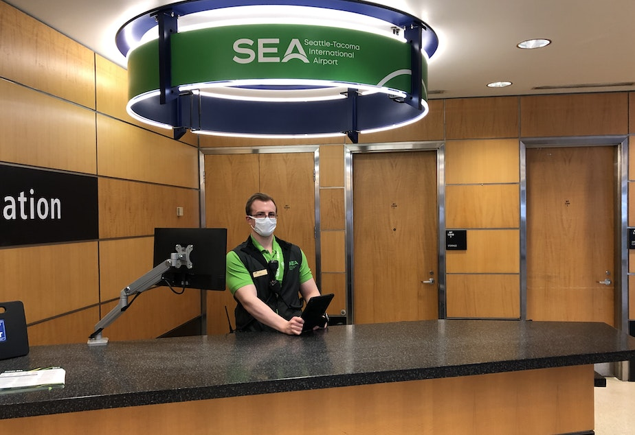 caption: Starting Monday, May 18th Sea-Tac mandates travelers wear a face mask and follow certain social distancing measures at the airport.