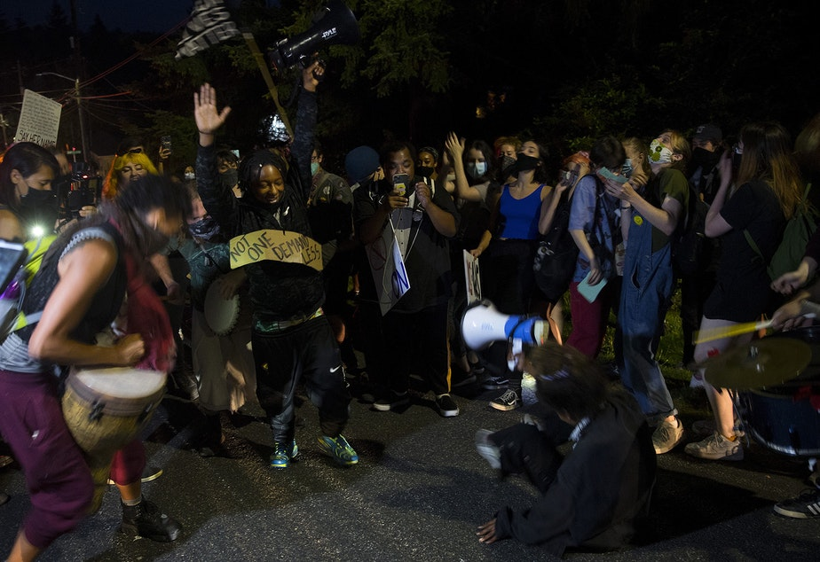 """caption: The Everyday March stops to dance while heading toward Seattle City Councilmember Debora Juarez's home in an effort to have a dialogue about racial justice and police brutality on Tuesday, August 4, 2020, in the Olympic Hills neighborhood of Seattle. """"It is on us,"""" said organizer Tealshawn Turner. """"It is our duty, our obligation, our responsibility to come out here and stand up for the next generation. You have to speak life into these children."""""""