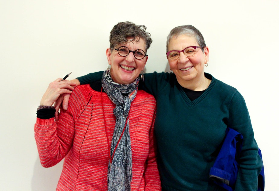 caption: KUOW's Marcie Sillman with book hugger Nancy Pearl.