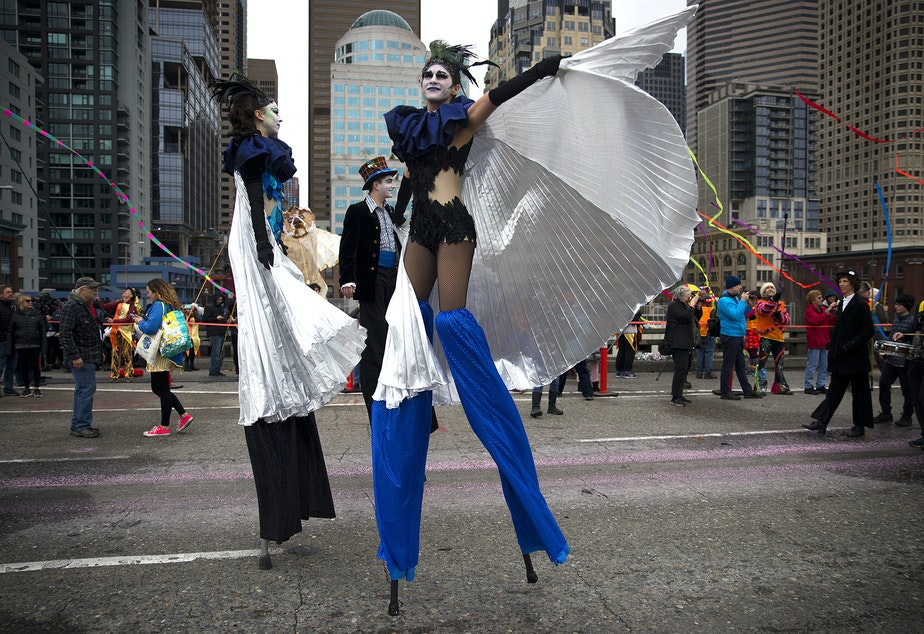 April McMorris, center, leads the Hello Goodbye music and performance procession on Saturday, February 2, 2019, during the Viaduct Arts Festival on the Alaskan Way Viaduct in Seattle.