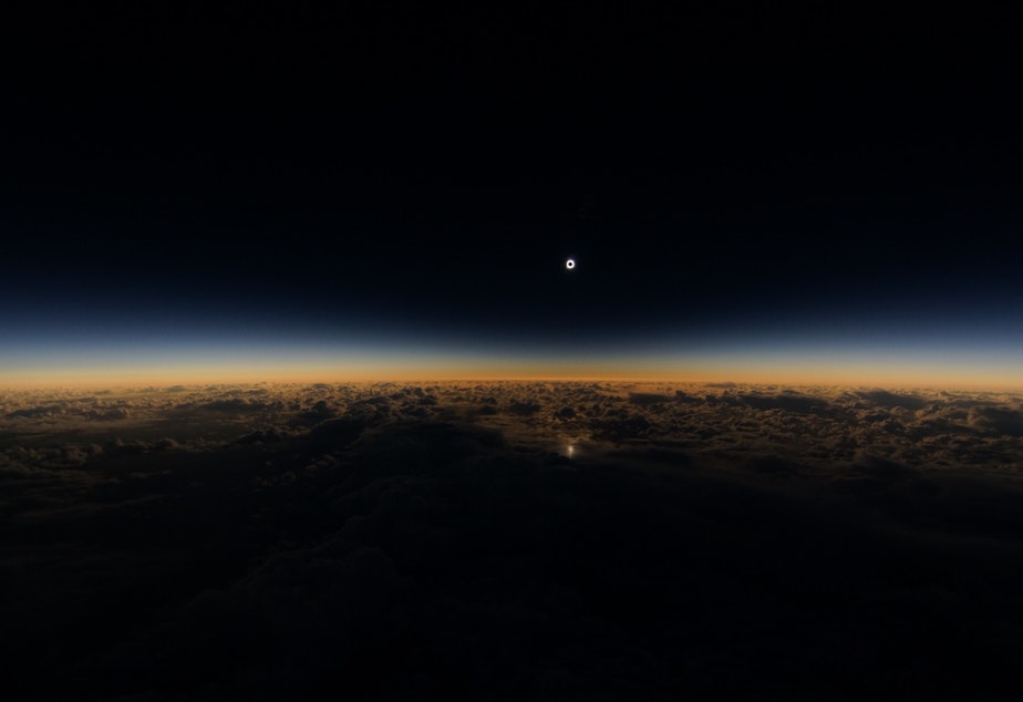 caption: Tuesday's solar eclipse as seen from Alaska Airlines flight 870