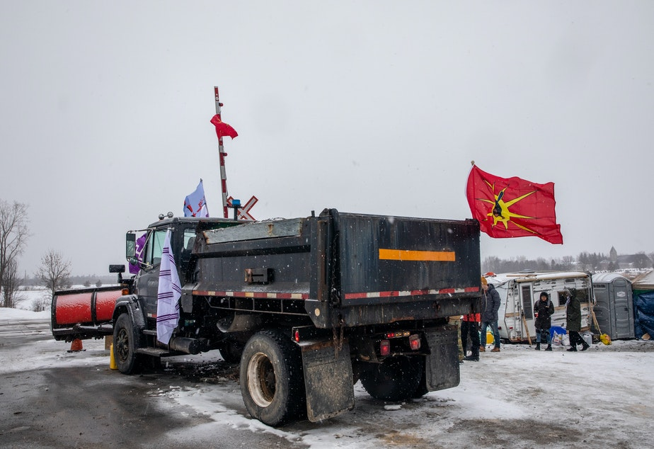 A truck sits parked at railway tracks during a protest near Belleville, Ontario, Canada, on Thursday. Demonstrators have been disrupting railroads and other infrastructure across Canada for more than a week to protest TC Energy Corp.'s planned $4.68 billion (6.2 billion Canadian dollar) Coastal GasLink pipeline.