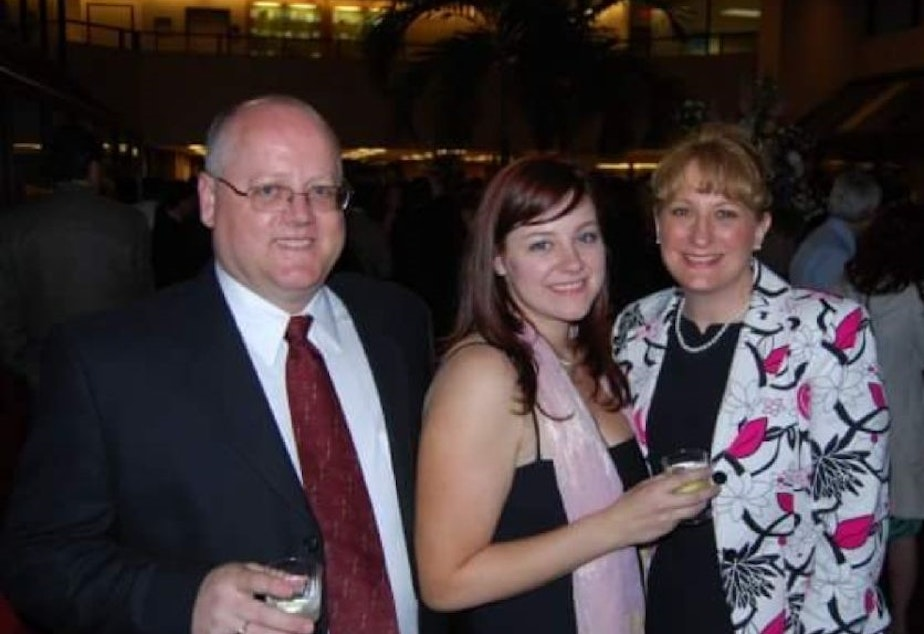 caption: From left: Matt Faber, Candace's father, Candace Faber, and her mother, Laura Lee Faber, the night of Candace's Georgetown graduation. She is wearing the dress she says Fain tore.