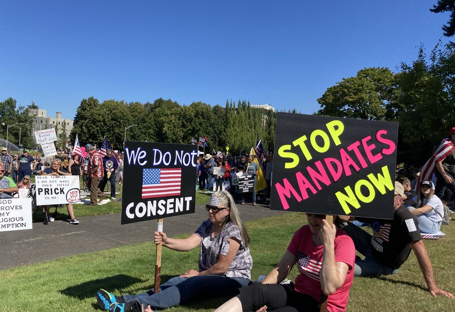 caption: People opposed to vax mandates protested at the Washington State Capitol in Olympia on multiple weekends during September.