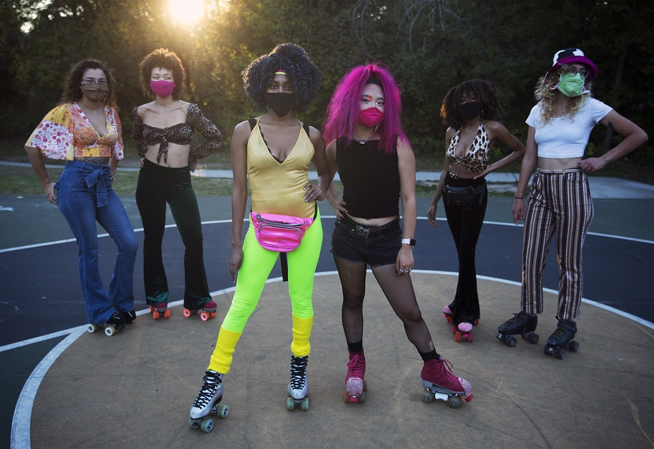 caption: Co-founders of Seattle Skates, Artemis Peacocke, center left, and Naima Pai, center right, pose for a portrait with roller skaters from left, Jenna O'Neil, Vanessa Poston, Nadia Morris and Erika Mazza-Smith, during a decades themed skate meet up on Tuesday, October 6, 2020, at the White Center Bicycle Playground in Seattle.