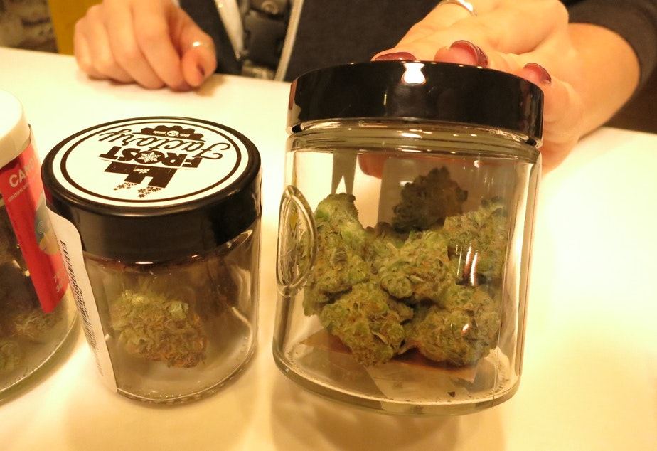 A budtender shows off product at the Canna West marijuana dispensary in West Seattle.