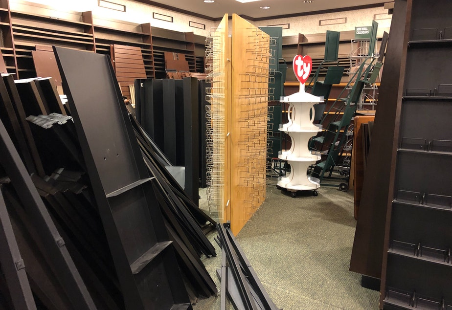 caption: Disassembled store shelves at Barnes & Noble in downtown Seattle.