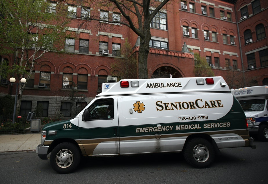 caption: An ambulance pulls up outside a nursing home in Brooklyn, N.Y. Two senators have called for an investigation of five states, including New York, which ordered nursing homes to admit patients who tested positive for COVID-19.